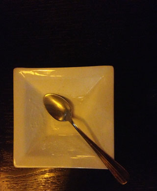 After the fancy dessert is eaten, the tiny plate is empty.