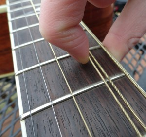pulling a guitar string