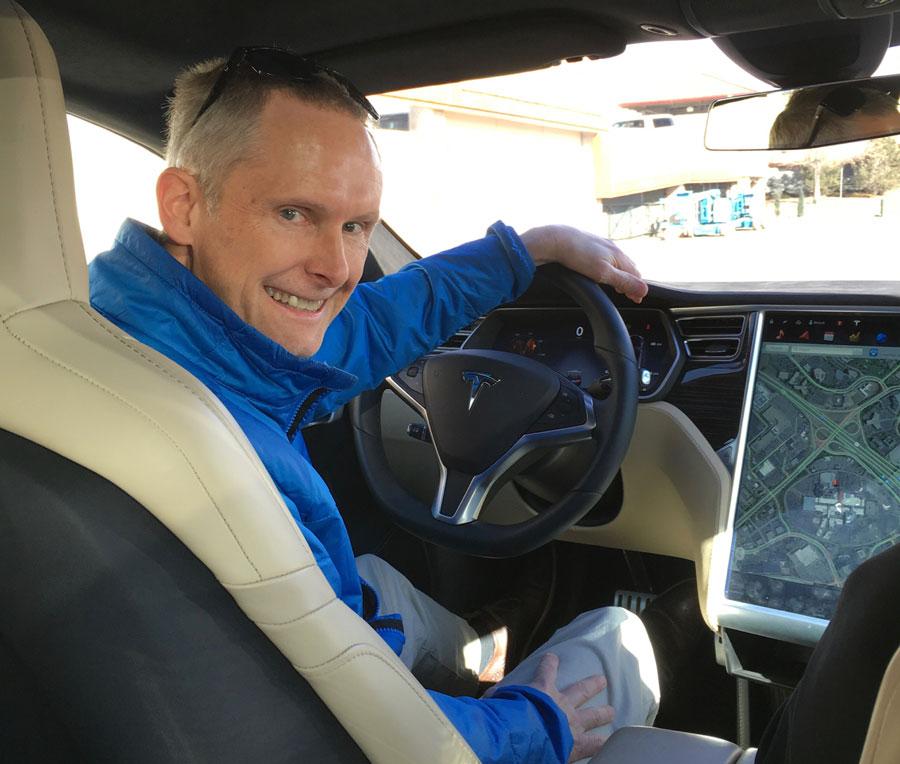 Paul behind the wheel of a Tesla P90D