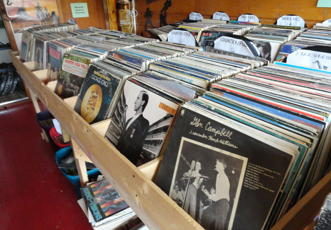 a collection of vinyl records at a thrift shop - copyright 2016 by paul merrill