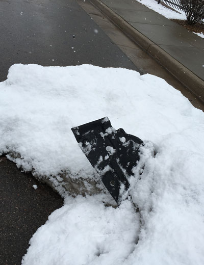 car parts in a snowbank