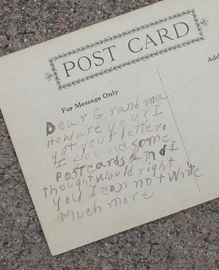 hand-written note on the back of an old postcard