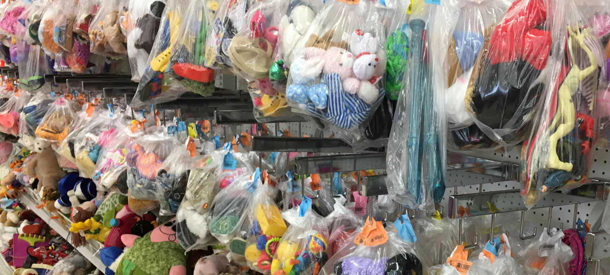 a sea of toys at a charity shop
