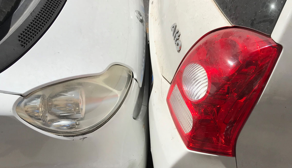 cars parked too close in Catania, Italy