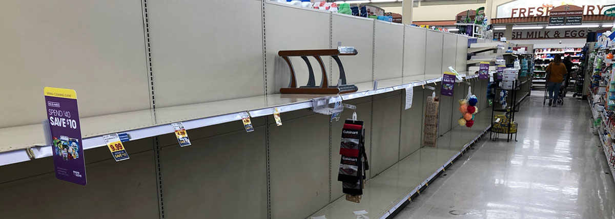 empty toilet paper shelves at the supermarket