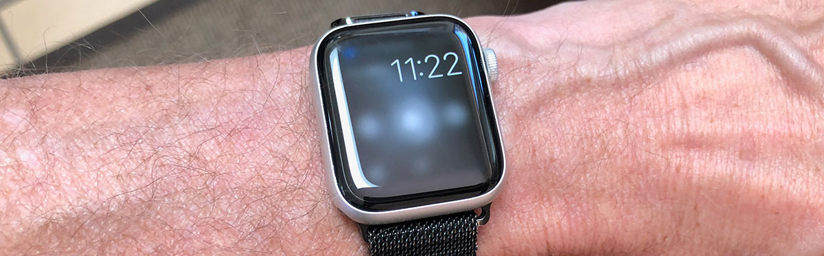 Apple Watch on a wrist, displaying just the time