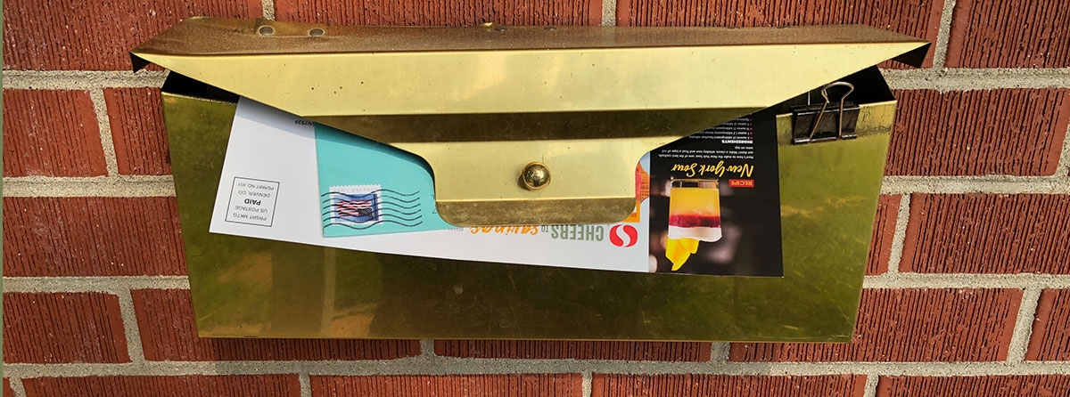 home mailbox with one letter and junk mail